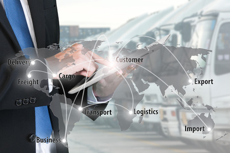 Photo for Businessman press digital tablet to show global network partnership connection use for logistic,import,export background. - Royalty Free Image
