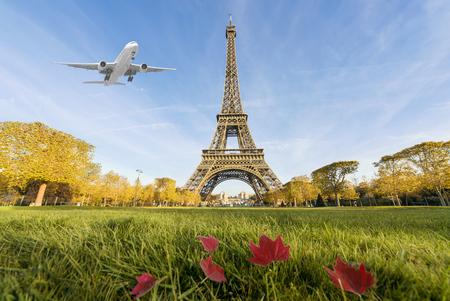 Airplane flying over Eiffel Tower, Paris, France. Eiffel Tower is international landmark in Paris, France
