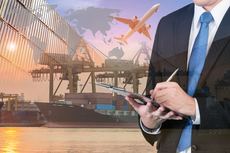 Photo pour Double exposure of businessman is booking with blurred cargo , transportation port and world map. Transportation logistic business concept. - image libre de droit