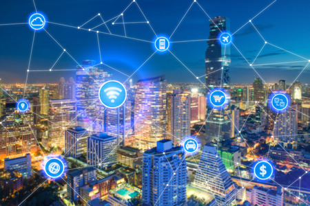 Foto de Smart city and wireless communication network, business district with office building, abstract image visual, internet of things concept - Imagen libre de derechos