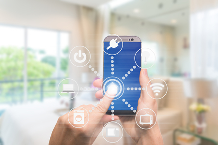 Photo for Smart home automation app on mobile with home interior in background. Internet of things concept at home. Smart technology 4.0 - Royalty Free Image