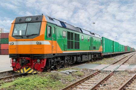 Foto de Cargo train platform with freight train container at depot in port use for export logistics background. - Imagen libre de derechos