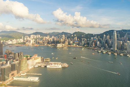 Photo for Aerial view of Hong Kong skyline and Victoria Harbor with blue sky in Hong Kong. Asia.  - Royalty Free Image
