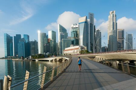 Photo for People jogging at morning in Singapore business district skyline financial downtown building with tourist sightseeing in day at Marina Bay, Singapore. Asian tourism, modern city life, or business finance and economy concept - Royalty Free Image