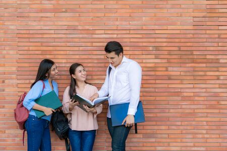Photo for Three Asian students are discussing about exam preparation, presentation, study, study for test preparation in University. Education, Learning, Student, Campus, University, Lifestyle concept. - Royalty Free Image