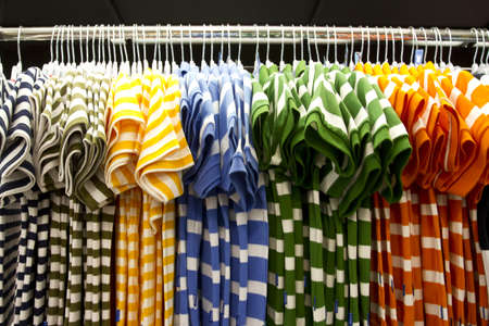 shirt row, colorful shirt arrange in a row in mall.