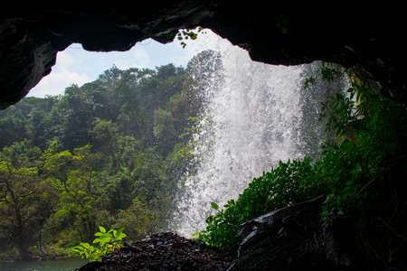 View of the beautiful Thoseghar waterfall from a cave. The waterfall is situated in Satara, India