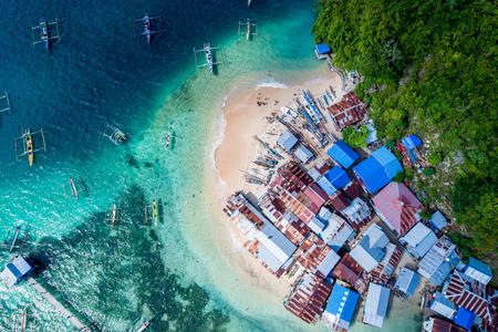 Photo pour Aerial View of White Sandy Beach Fishing Village, Jayapura Papua Indonesia, Asia - image libre de droit