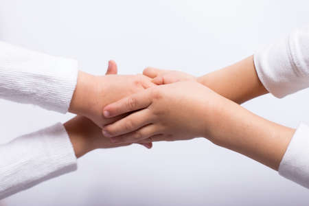 Photo for reconciliation between children, kid's hands on each other - Royalty Free Image