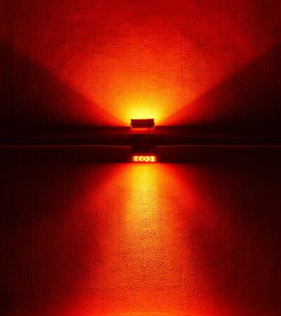 Wall is lit from red light. Abstract background or texture.