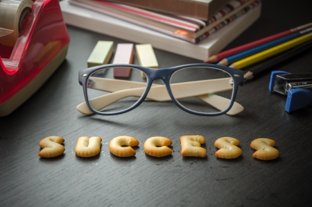 The words  success made of cookies, glasses and stationeries on table, lomo style