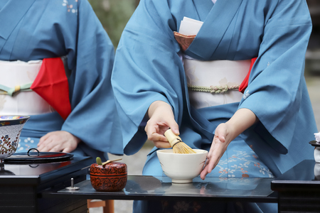 Photo for Japanese woman in traditional kimono preparing japanese green tea ceremony at garden - Royalty Free Image