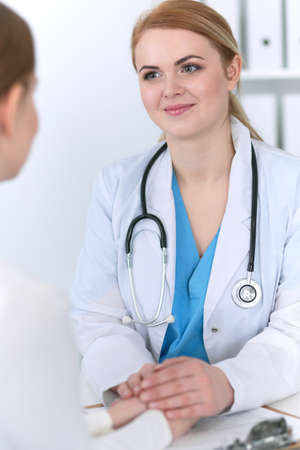 Medicine doctor reassuring her female patient. Medicine, comforting  and trusting concept in health care