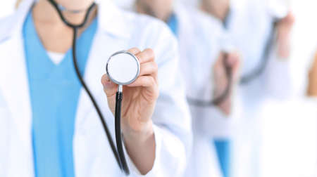 Groupe of medicine doctors holding stethoscope head closeup. Physicians ready to examine and help patient. Medical help and insurance in health care, best treatment concept. Photo for advertisement.