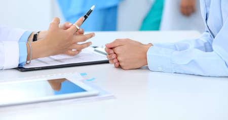 Foto de Doctor and patient discussing something, just hands at the table, white background - Imagen libre de derechos