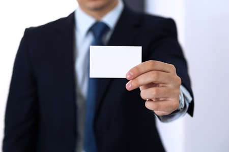 Foto de Unknown businessman hand holding business card with empty space, close-up - Imagen libre de derechos