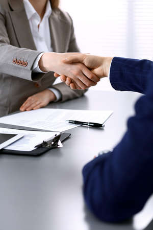 Photo for Business people shaking hands, finishing up a meeting. Papers signing, agreement and lawyer consulting concept. - Royalty Free Image