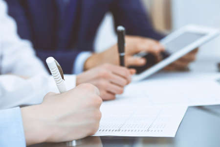Foto de Bookkeepers team or financial inspectors  making report, calculating and checking balance. Tax service financial document. Audit or meeting concept - Imagen libre de derechos