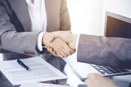 Photo pour Business handshake after contract signing. Two women shaking hands after meeting or negotiation. - image libre de droit