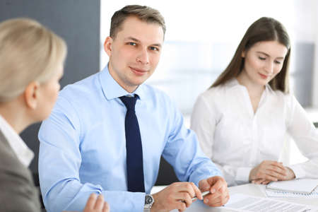 Photo pour Group of business people discussing questions at meeting in modern office. Headshot of businessman at negotiation. Teamwork, partnership and business concept - image libre de droit