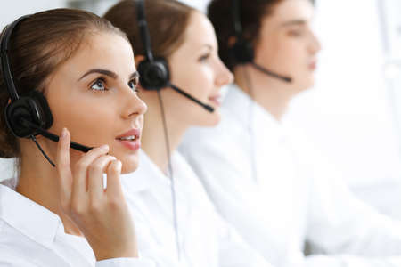 Photo for Call center. Beautiful young woman using headset and computer to help customers. Business concept - Royalty Free Image