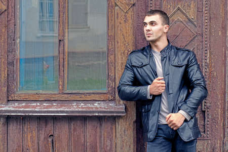 portrait of the brutal young man in a leather jacket