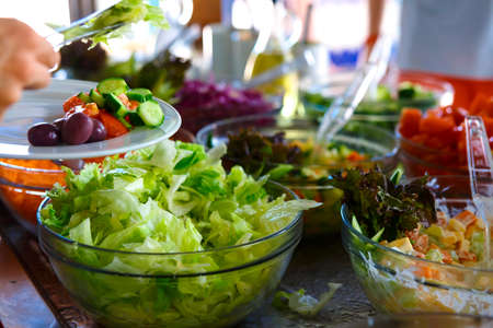 Photo pour Salad buffet. The people themselves impose the desired treat. - image libre de droit