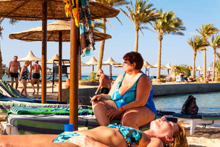 HURGHADA, EGYPT - MAY 16, 2015: People resting on the beach