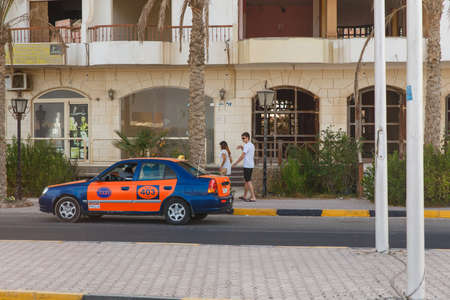 HURGHADA, EGYPT - MAY 20: Taxi driver obsession offers its service to a pair of European tourists. Hurghada, Egypt. May 20, 2015