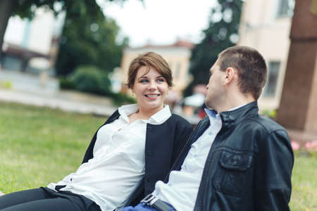 Photo for Portrait of two beautiful young lovers in the park - Royalty Free Image