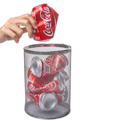KUALA LUMPUR, MALAYSIA - FEBRUARY 6TH 2015. Recycling Coca Cola cans. Coca Cola drinks are produced and manufactured by The Coca-Cola Company, an American multinational beverage corporation