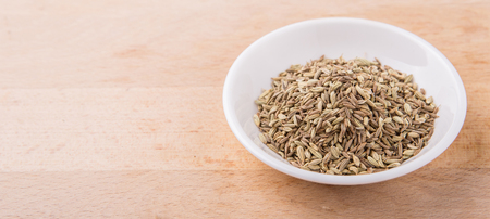 Cumin seed in white bowl