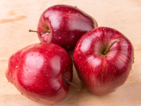 Photo for Red apples over wooden background - Royalty Free Image