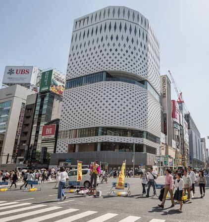 GINZA,TOKYO, JAPAN - MAY 6TH, 2016. Tourists and locals walking in Ginza Street, an upscale and popular shopping district in Tokyo.