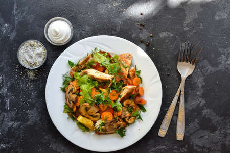 Photo for Grilled vegetables and chicken breast salad. Chicken breast, salad, mushrooms, tomatoes, orange. Top view. Free space for text. Dark background - Royalty Free Image