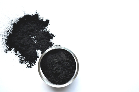 Photo pour Powdered activated charcoal in a glass jar. Natural ingredient for beauty treatments, skin care, detox face masks, dental care. - image libre de droit