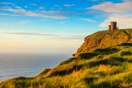 Foto de  Cliffs of Moher - O Briens Tower castle at sunset  in Co. Clare Ireland Europe. - Imagen libre de derechos