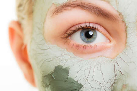 Photo for Woman in clay mud mask on face isolated on white. Girl taking care of dry complexion. - Royalty Free Image