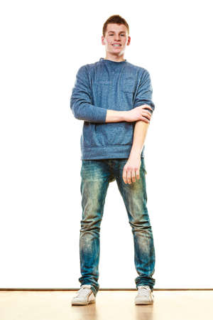 Photo pour Young fashionable man teen boy in full length casual style blue jeans posing isolated on white - image libre de droit