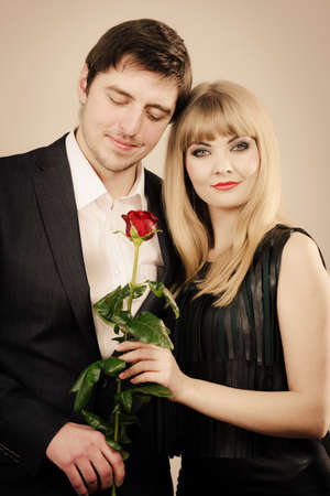 Date flirt and love concept. Valentine\'s Day. Attractive blonde woman with handsome man dating. Elegant glamorous couple pare fall in love.