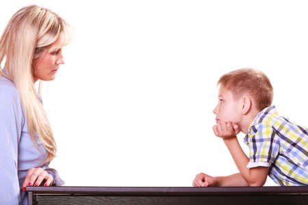 Photo for Relationships arguments and discussion. Mother and son sit at table and argue discuss solve problem. - Royalty Free Image