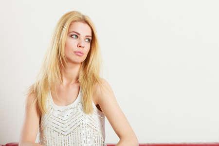 Beauty of feminine, beautiful women concept. Attractive blonde woman looking at copyspace