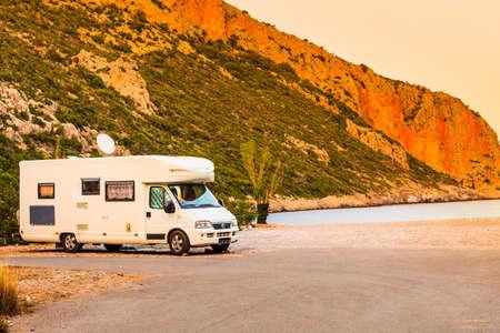 Photo pour Tourism vacation and travel. Camper van on beach sea shore in summer time, Greece - image libre de droit