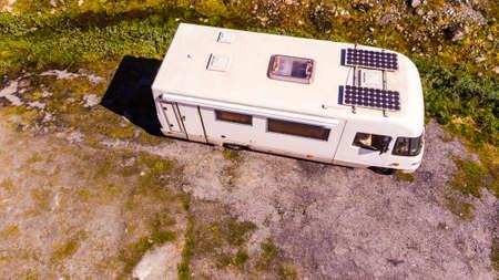 Photo pour Tourism vacation and travel. Camper van with solar panels on roof in summer mountains landscape. National tourist route Aurlandsfjellet. - image libre de droit