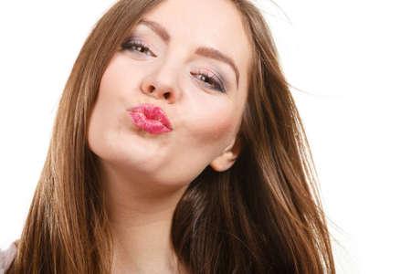Photo pour Portrait of happy attractive woman having long brown straight hair wearing light jumper sending air kisses - image libre de droit