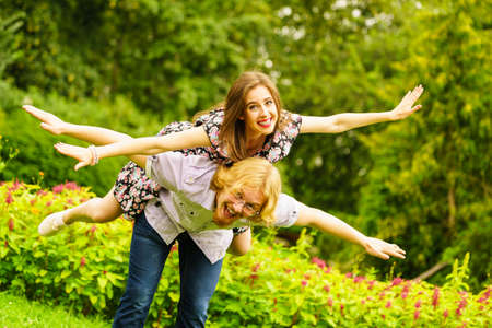 Photo pour Happy couple having fun together outdoor. Happines, great relationship. Man and woman fooling around. - image libre de droit