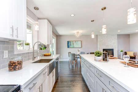 Photo pour Gorgeous kitchen with open concept floorplan, white cabinets and huge island. - image libre de droit