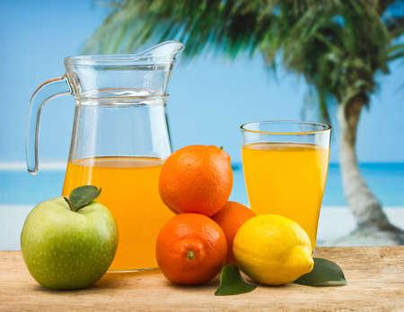 Photo pour orange juice in a glass on a table with oranges - image libre de droit