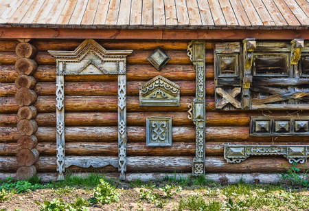 Traditional wooden Russian carved platband of an old wooden house in the province city