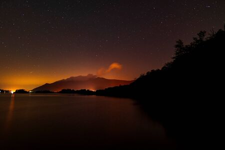 Photo for Derwent water from Ashness jetty with the plough in the night sky - Royalty Free Image